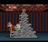 Super Street Fighter II SNES Bonus Stage 2: With the help of some blows, a big stack of bricks must be demolished.