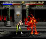 Mortal Kombat 3 SNES Sonya Blade applying her Fatality Kiss of Death in Cyrax.
