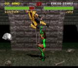 Mortal Kombat II SNES Jade throws her fan into Scorpion, but he is almost striking back with a jump kick...
