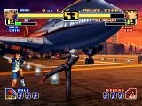 The King of Fighters: Evolution Windows Airport - The background scenery is rendered in 3D.
