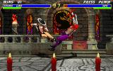 Mortal Kombat 3 DOS Kung Lao performs his diagonal kick on Jax