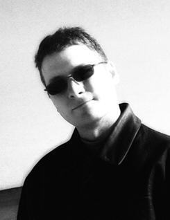 Black and white picture of Ray circa 2004 (image from http://www.firewalkdigital.com/raylarabie.html)