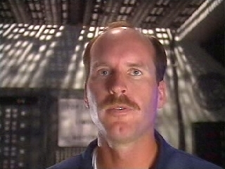 Frank Leslie playing the Officer of the Deck in Silent Steel, circa 1995.
