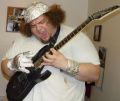 Joshua Billeaudeau often uses guitars in some of his musical compositions for video games. The tinfoil, he claims, acts as a conduit of his musical aura. (April 29, 2006)