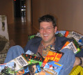 Randy Pitchford in a pile of his games (2007)