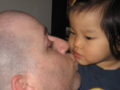 My daughter Esther and I exchange a kiss.  2007.
