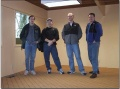 Founding members of GarageGames proudly showing off their first office. (l/r) Tim Gift, Jeff Tunnell, Mark Frohnmayer, and Rick Overman.