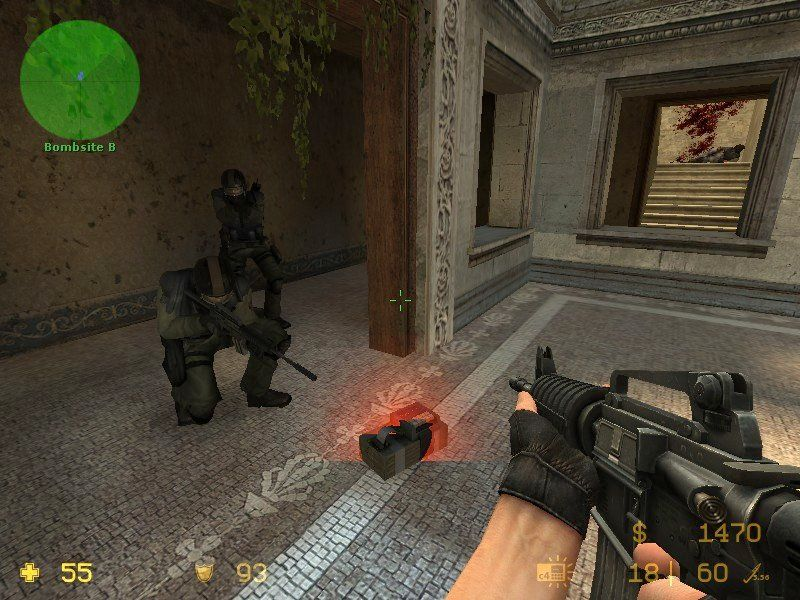 Counter-Strike: Source Windows Counter Terrorists defusing a bomb.