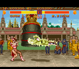 Street Fighter II SNES M. Bison strikes back the Chinese fighter with a Psycho Crusher, but she prepares the defense at time.