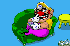 WarioWare, Inc.: Mega Microgame$! Game Boy Advance Wario lying on his couch and pickin' at it.