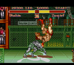 Super Street Fighter II SNES Dhalsim launches Zangief with a successful throw.