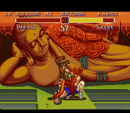 Super Street Fighter II SNES Dee Jay's Machine Gun Uppercut forces Sagat to do a very closing defense position.