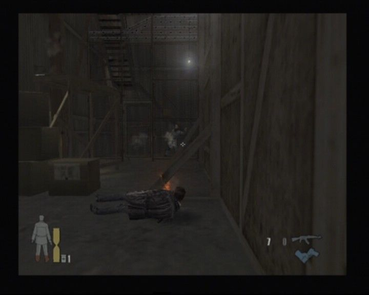 "Max Payne 2: The Fall of Max Payne PlayStation 2 ""A typical slow-motion slide and shoot"" by Max Payne"