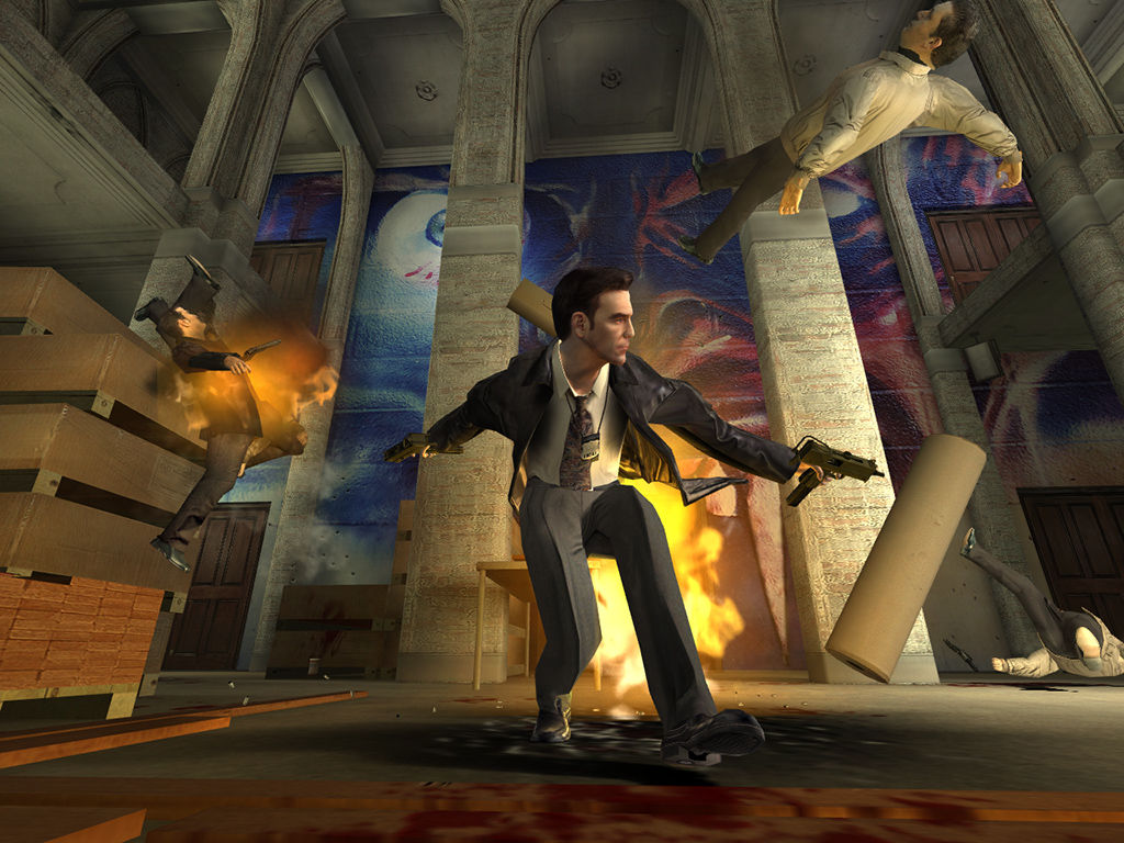 Max Payne 2: The Fall of Max Payne Windows Reloading amidst the chaos.