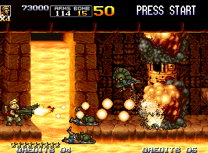 Metal Slug 5 Neo Geo Marco (in Fat Mode) uses the power of his boosted Dual machine Gun to demolish a tribesman tower.