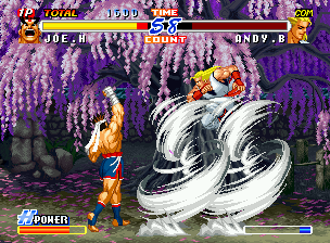 Real Bout Fatal Fury 2: The Newcomers Neo Geo CD Trying to avoid Joe Higashi's Exploding Hurricane move, Andy Bogard executes a very risky jump.
