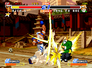 Real Bout Fatal Fury 2: The Newcomers Neo Geo CD Rick Strowd strikes back Tung Fu Rue with the strong impact of his cross-shape move Hellion.