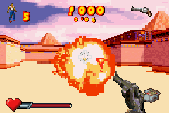 Serious Sam Game Boy Advance Blowing up a beheaded kamikaze with a well-place shot from a Schofield pistol