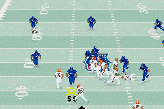 Madden NFL 2003 Game Boy Advance Number 59 plows through the offense trying for a blitz.