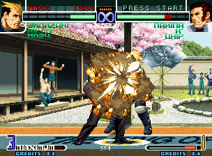 The King of Fighters 2002: Challenge to Ultimate Battle Neo Geo Ryuji Yamazaki grabs Maxima and strikes back through his explosive-smoking move Bakudan Pachiki.