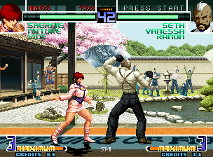 The King of Fighters 2002: Challenge to Ultimate Battle Neo Geo Seth uses his move Back Blow in the instant that Shermie ends her move Baku New Suplex: advantage!