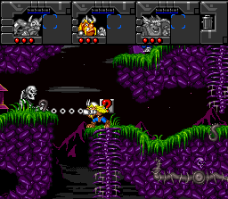 Norse by Norse West: The Return of the Lost Vikings SNES Baleog using his new bionic arm to beat an enemy at distance.