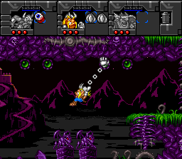 Norse by Norse West: The Return of the Lost Vikings SNES Baleog using his bionic arm to play Tarzan.