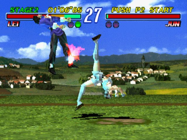 Tekken 2 PlayStation Jun hits Lei with a back-flip.