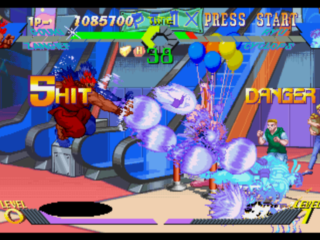 "X-Men vs. Street Fighter PlayStation Gouki (Akuma) using his Hyper Combo Tenma Gou Zankuu to leave Ryu's life meter in ""DANGER"" state..."