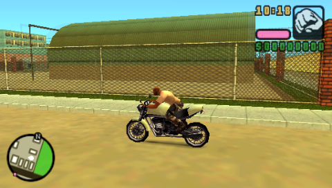 Grand Theft Auto: Vice City Stories PSP Driving around the barracks with a sweet bike