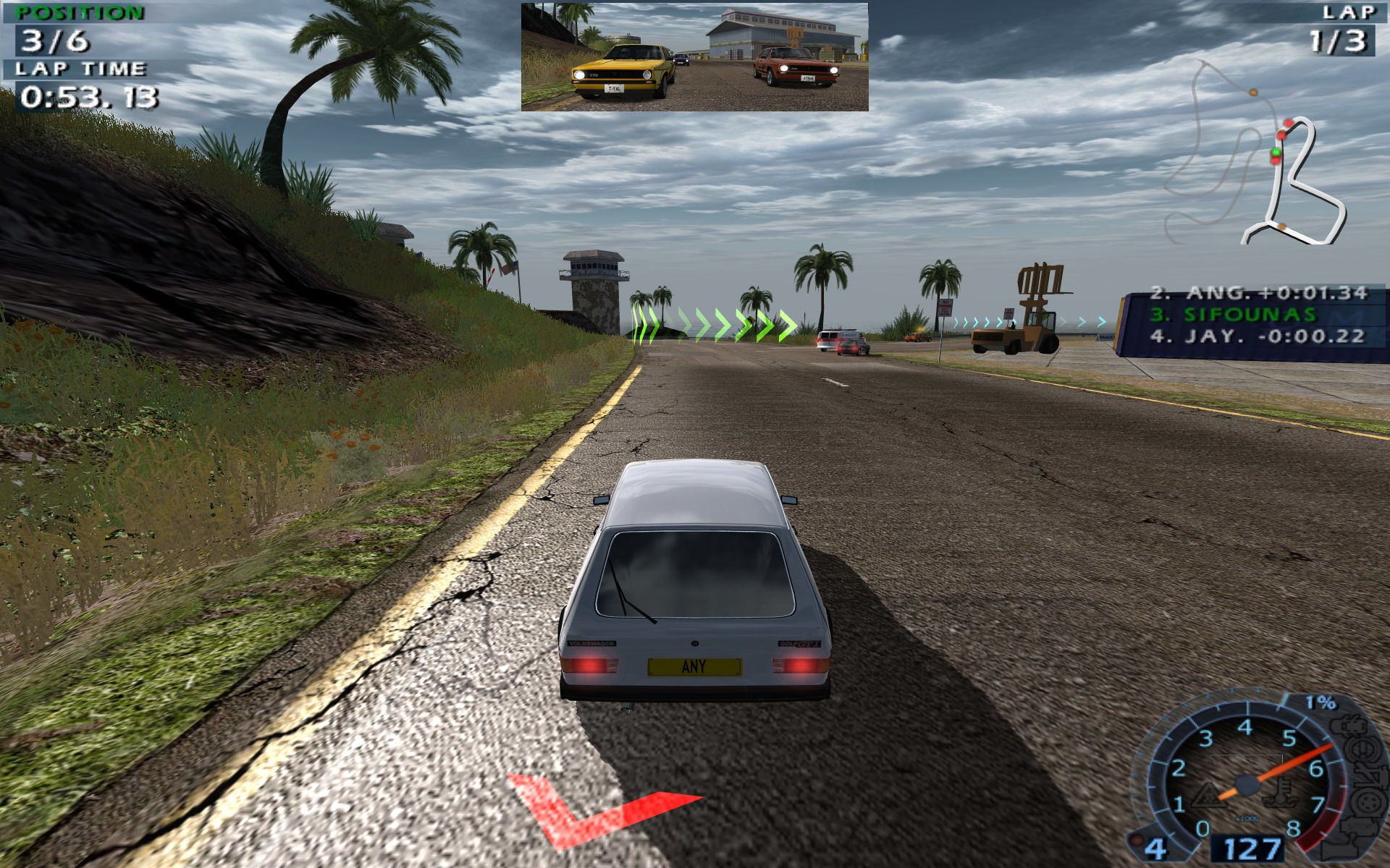 World Racing 2 Windows The red arrow behind the player's car indicates that an opponent is very close