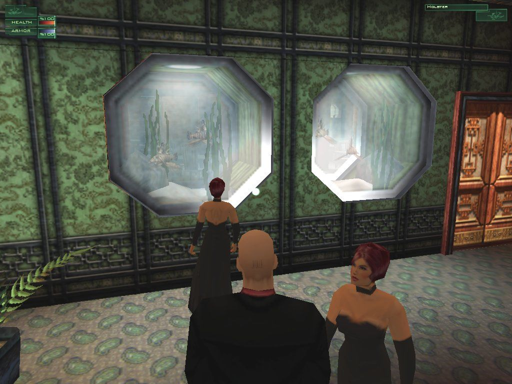 Hitman: Codename 47 Windows Rieper admires the fishies, while a lady admires Rieper. A shame he doesn't prefer women.