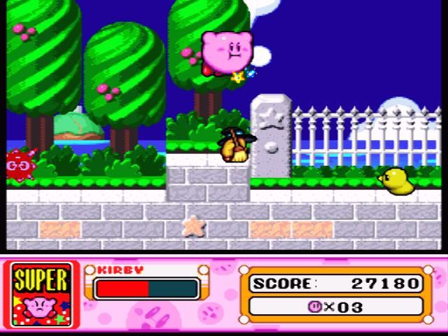 Kirby Super Star SNES Flying over the fence