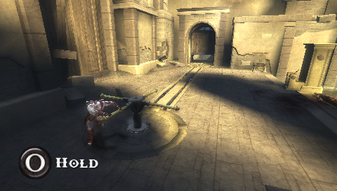 God of War: Chains of Olympus PSP Turn cranks to open doors.