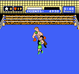 Mike Tyson's Punch-Out!! NES Hitting Von Kaiser with an uppercut, sending him flying.
