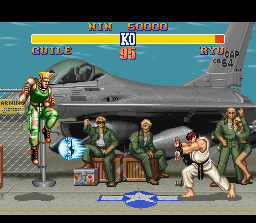 Street Fighter II SNES Guile jumps over, what is probably, the most famous projectile ever to be included in a fighting game.