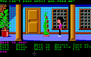 Maniac Mansion Amiga Wendy runs into Green Tentacle. He won't let her pass until he gets some food.