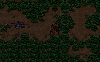 Jungle Strike DOS Level 4 - Near a guard tower. This is a night mission, and the darkness makes it hard to see.