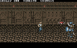 Double Dragon III: The Sacred Stones DOS Facing the boss of the catacombs. If he wasn't a challenge enough there's that red spiked object bouncing around all over the place.