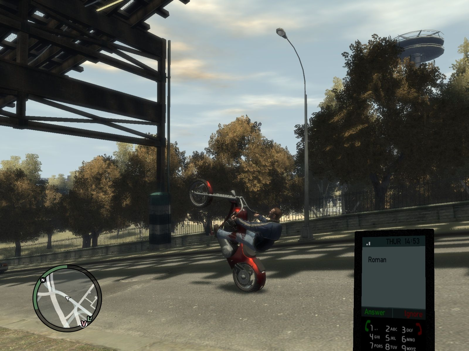 Grand Theft Auto IV Windows Roman calling me while I'm doing a wheelie.