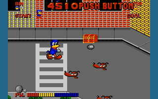 Dynamite Düx Amiga Throwing rocks at enemy.