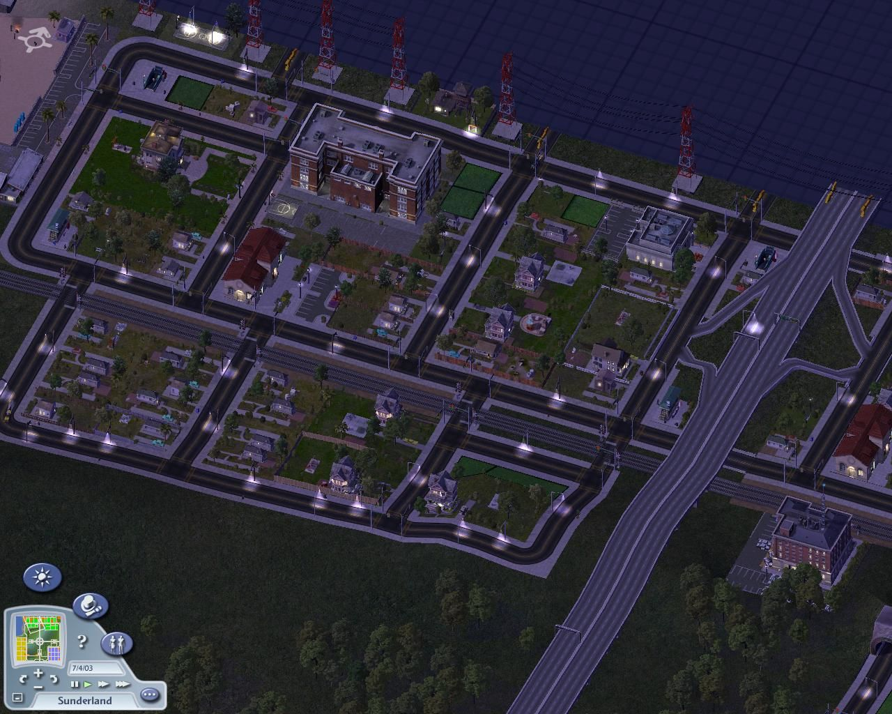 SimCity 4 Windows A small residential area at nighttime.