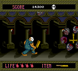 Splatterhouse TurboGrafx-16 Stage 4 boss-- a series of severed heads revolving around an upside-down cross
