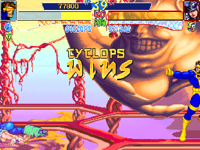 X-Men: Children of the Atom DOS Under the portrait, some symbols show how a won round had ended. A clock means a time victory, a V means the finishing move was a simple blow, a Ss round ended with an Hyper X move.