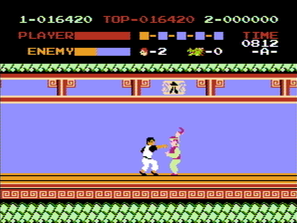 Kung-Fu Master NES 2nd boss throws boomerangs.