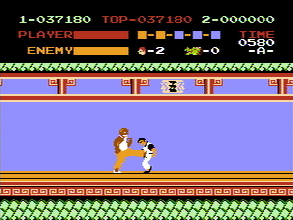 Kung-Fu Master NES 3rd boss kicking Thomas.