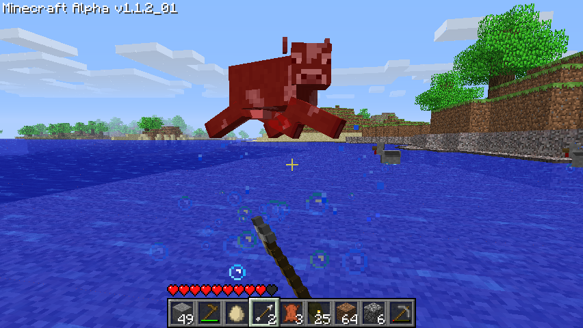 Minecraft Windows Attacking a cow with my pointy stick. I hope he can swim.
