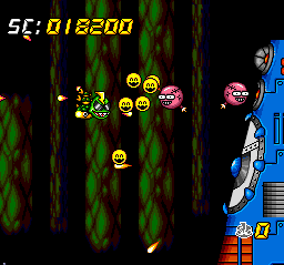 Super Air Zonk: Rockabilly-Paradise TurboGrafx CD Boss battle against a wall that spits out smiling faces