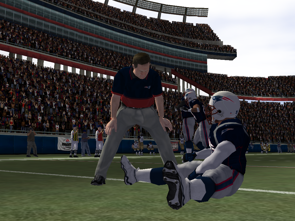 Madden NFL 2003 Windows Bill Belichick consults a player during pregame warm-ups.