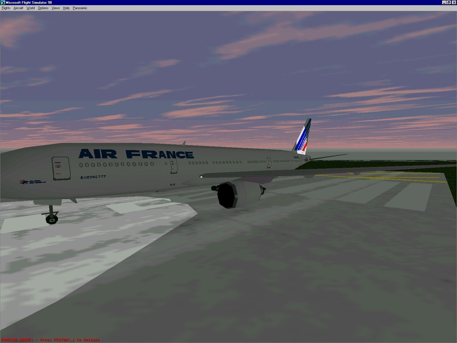 The Air France Plane On The Runway At Dusk. The Navigation Lights Are On.  The The Anti Collision Lights Do Flash Though This Is Not Shown Here.